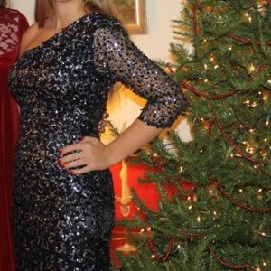 Gorgeous Sherri Hill one sleeve sequin dress. Prom
